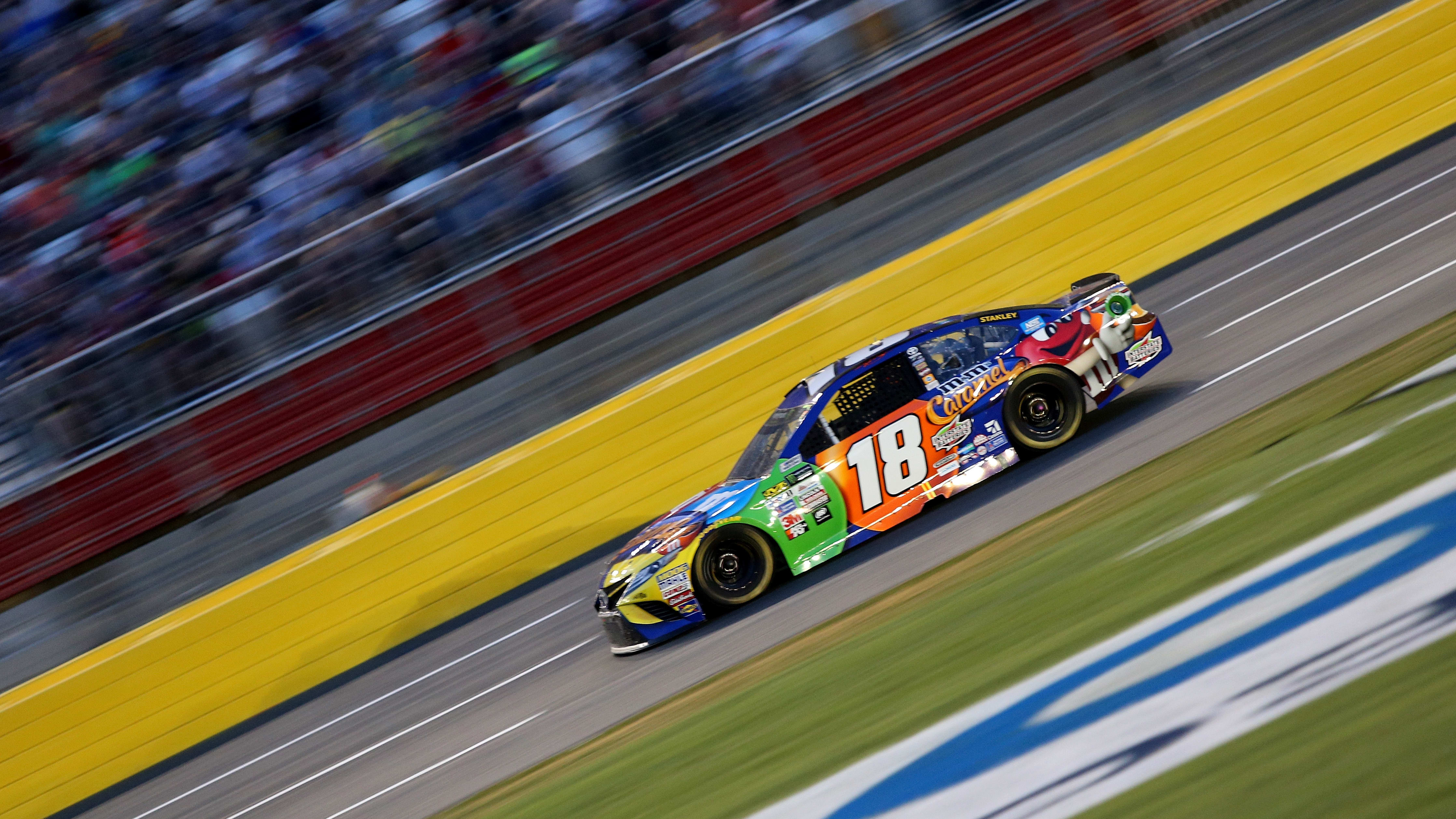 CHARLOTTE, NC - MAY 20:  Kyle Busch, driver of the #18 M&M's Caramel Toyota, races during the Monster Energy NASCAR All Star Race at Charlotte Motor Speedway on May 20, 2017 in Charlotte, North Carolina.  (Photo by Jerry Markland/Getty Images)
