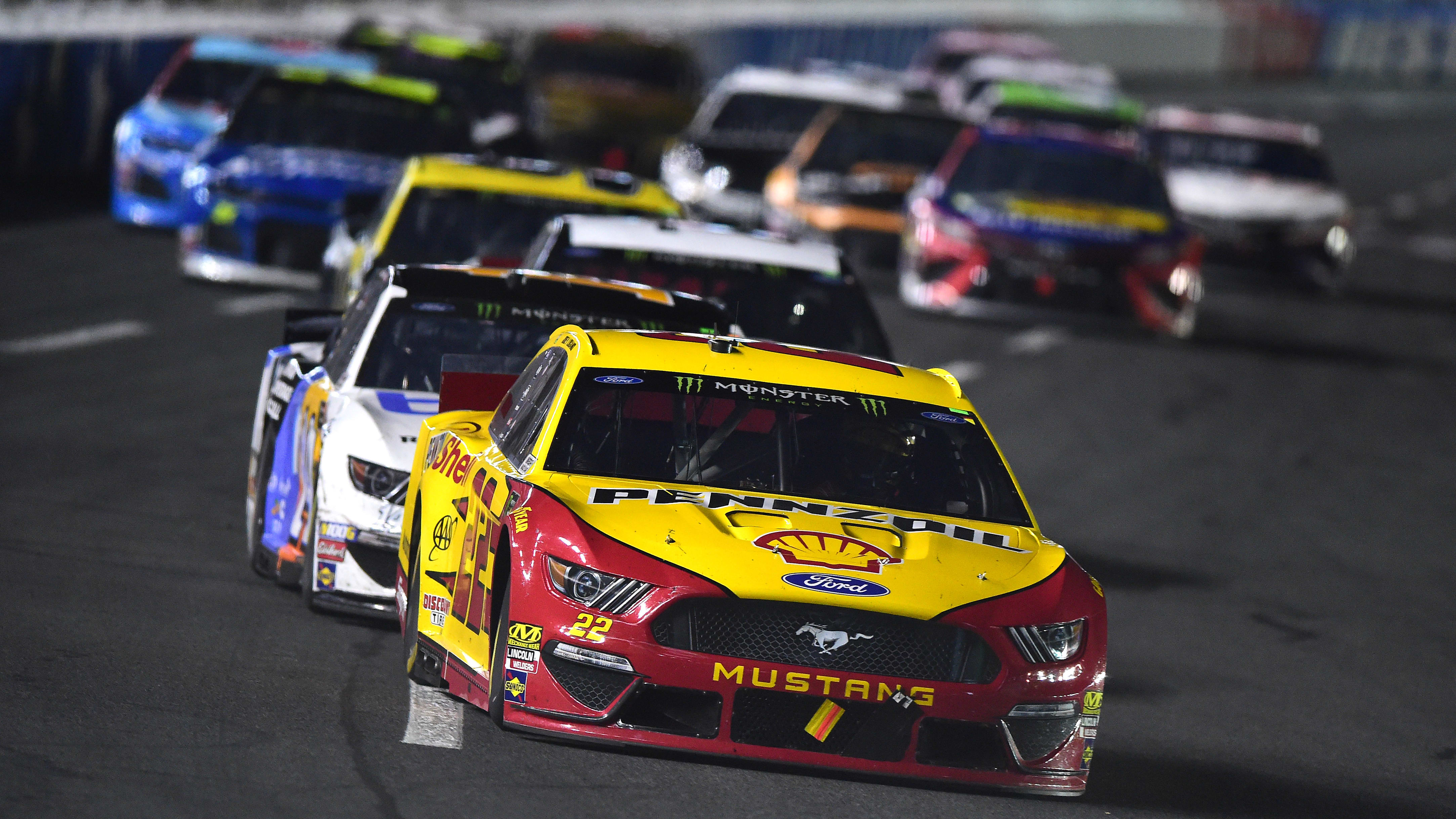 CHARLOTTE, NORTH CAROLINA - MAY 18: Joey Logano, driver of the #22 Shell Pennzoil Ford, leads a pack of cars during the Monster Energy NASCAR Cup Series All-Star Race at Charlotte Motor Speedway on May 18, 2019 in Charlotte, North Carolina. (Photo by Jared C. Tilton/Getty Images)