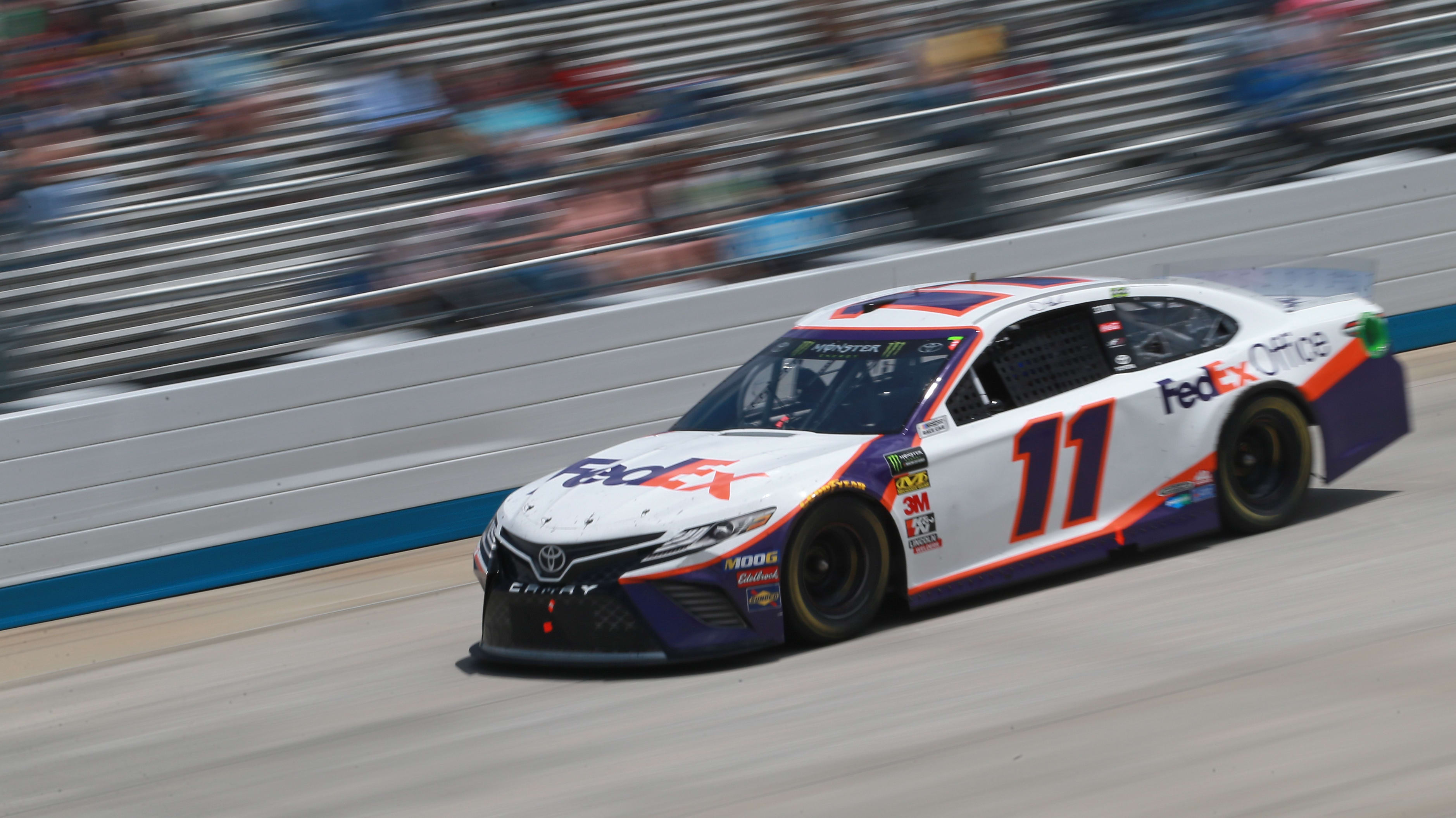 DOVER, DE - MAY 06:  Denny Hamlin, driver of the #11 FedEx Office Toyota, races during the Monster Energy NASCAR Cup Series Gander RV 400 at Dover International Speedway on May 6, 2019 in Dover, Delaware.  (Photo by Matt Sullivan/Getty Images)
