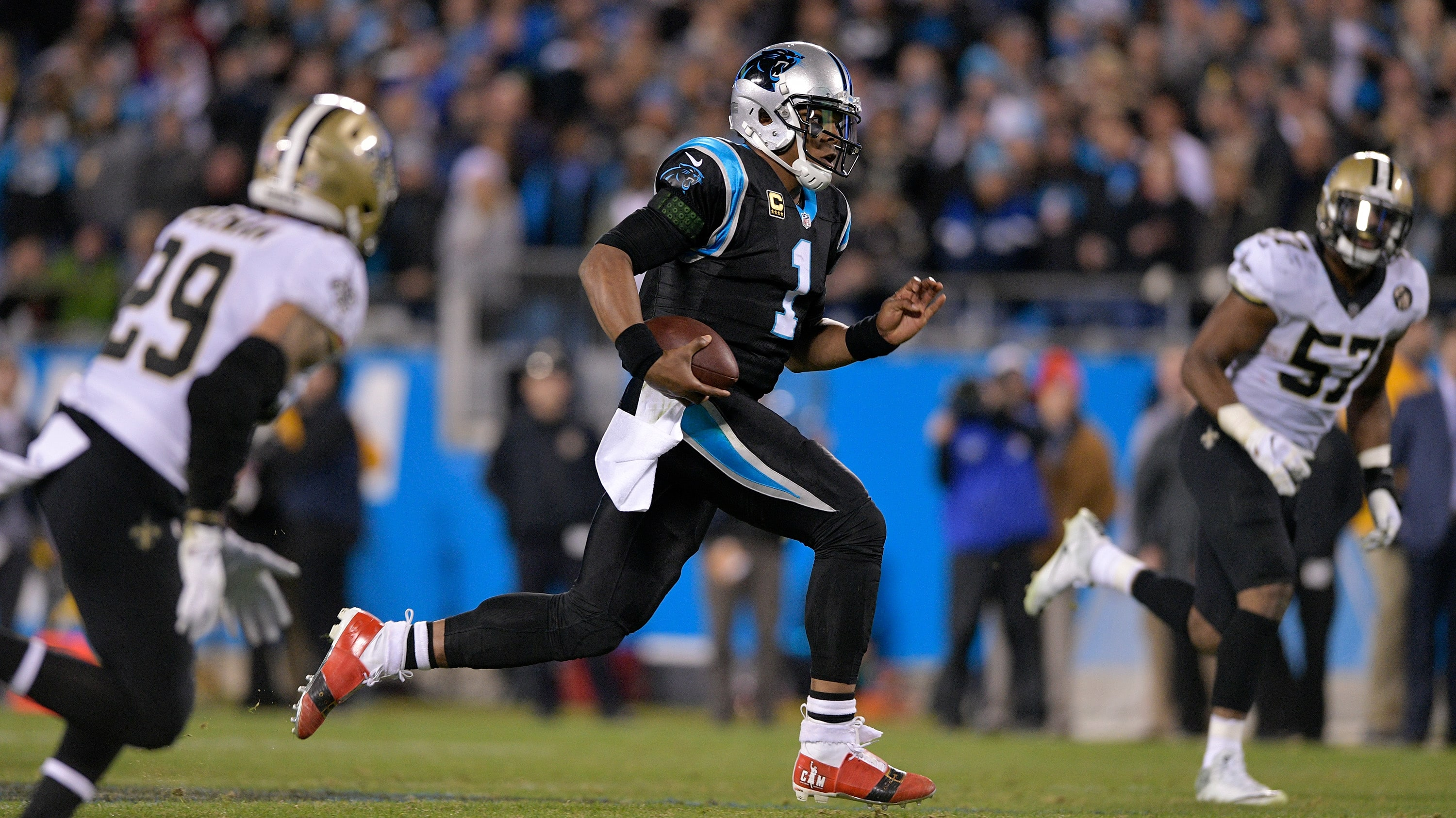 CHARLOTTE, NC - DECEMBER 17:  Cam Newton #1 of the Carolina Panthers runs the ball against the New Orleans Saints in the fourth quarter during their game at Bank of America Stadium on December 17, 2018 in Charlotte, North Carolina.  (Photo by Grant Halverson/Getty Images)