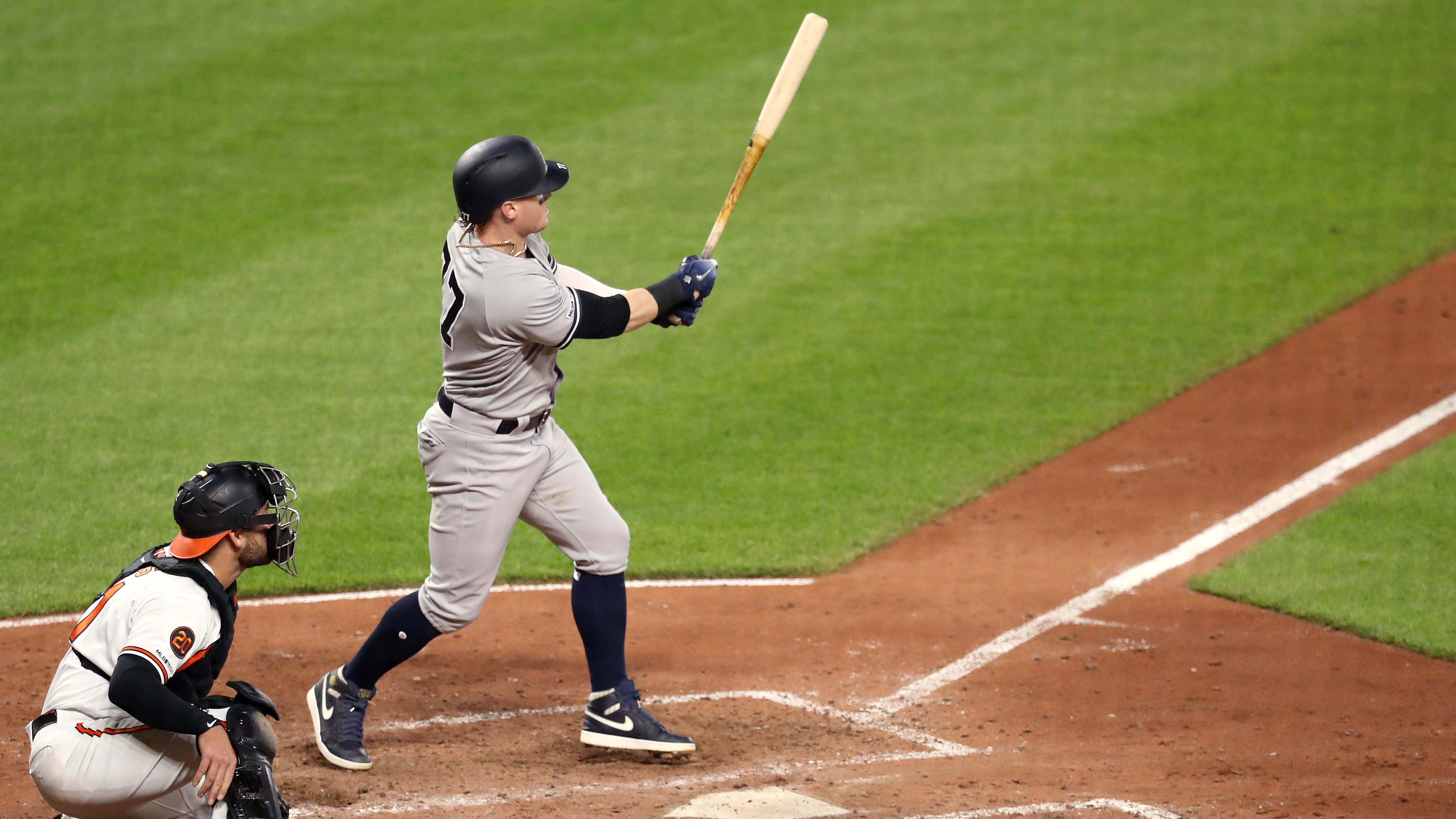 BALTIMORE, MARYLAND - MAY 21: Clint Frazier #77 of the New York Yankees follows his three RBI home run as catcher Austin Wynns #61 of the Baltimore Orioles looks on in the fifth inning at Oriole Park at Camden Yards on May 21, 2019 in Baltimore, Maryland. (Photo by Rob Carr/Getty Images)