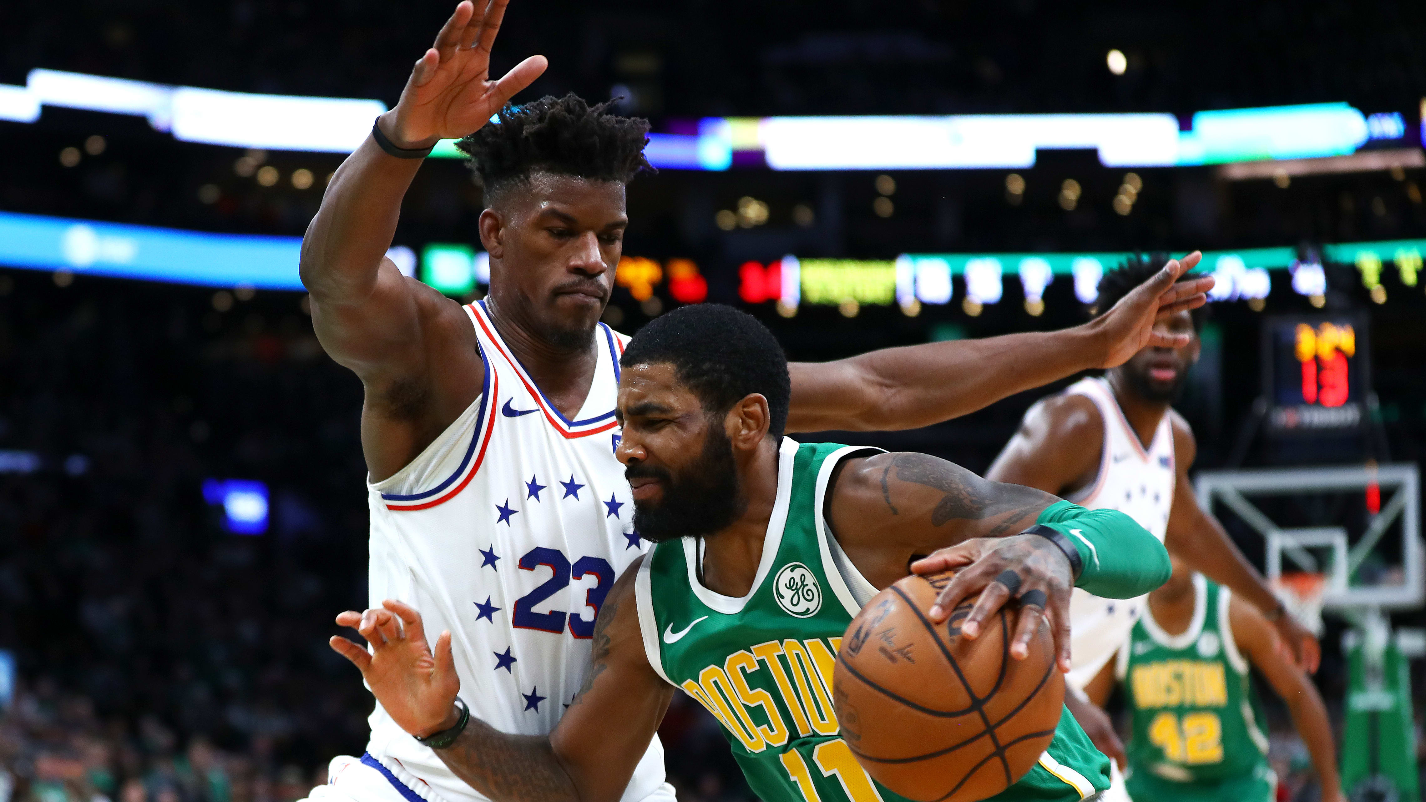 BOSTON, MASSACHUSETTS - DECEMBER 25: Kyrie Irving #11 of the Boston Celtics drives to the basket on Jimmy Butler #23 of the Philadelphia 76ers during the fourth quarter of the game at TD Garden on December 25, 2018 in Boston, Massachusetts. NOTE TO USER: User expressly acknowledges and agrees that, by downloading and or using this photograph, User is consenting to the terms and conditions of the Getty Images License Agreement. (Photo by Omar Rawlings/Getty Images)