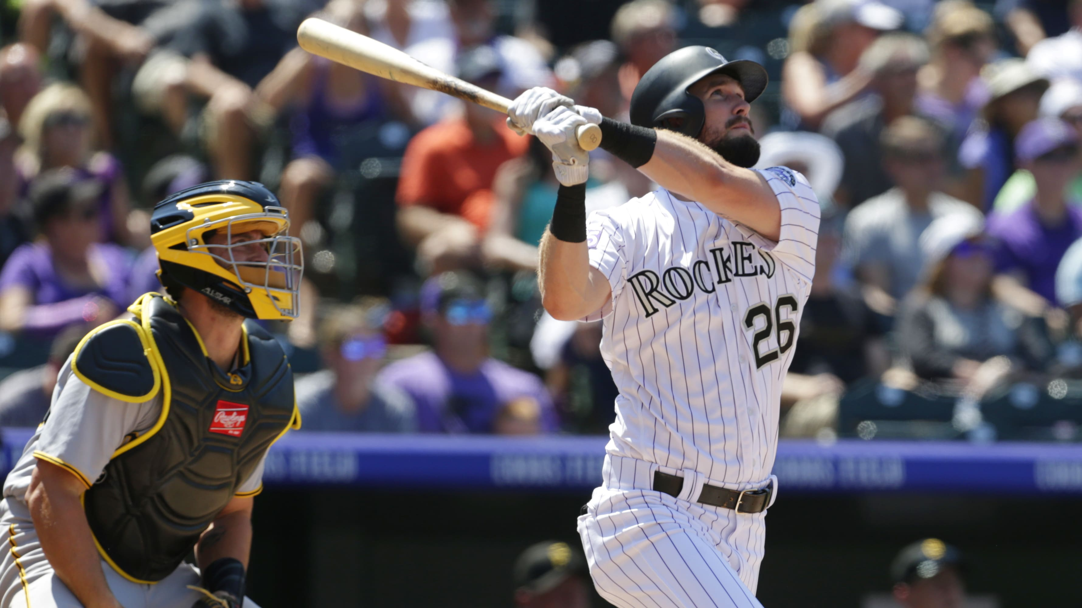 DENVER, CO - AUGUST 08: Francisco Cervelli #29 of the Pittsburgh Pirates watches as David Dahl #26 of the Colorado Rockies hits a two-run home run in the fourth inning at Coors Field on August 8, 2018 in Denver, Colorado. (Photo by Joe Mahoney/Getty Images)