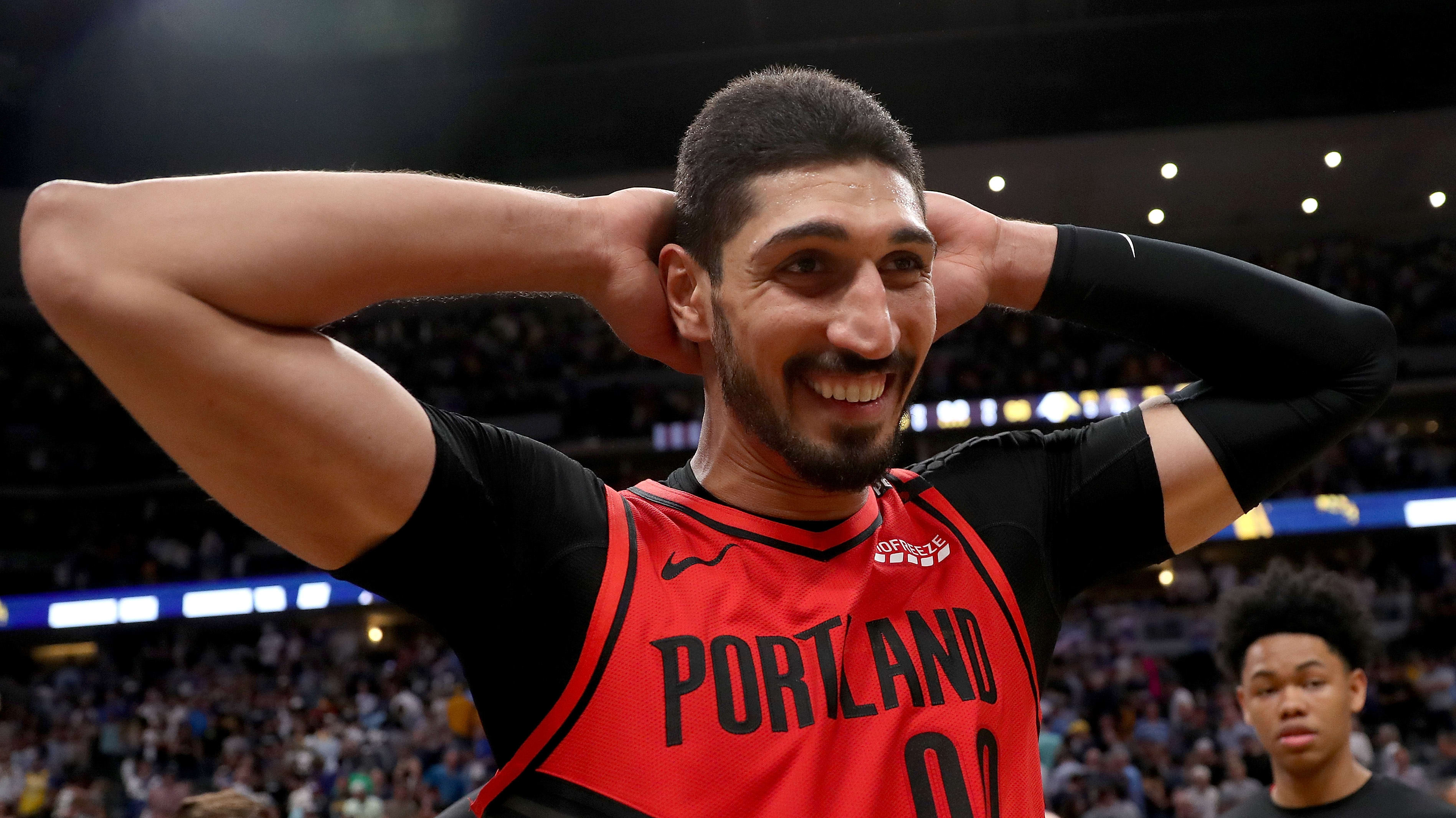 DENVER, COLORADO - MAY 12: Enes Kanter #00 of the Portland Trail Blazers celebrates their win against the Denver Nuggetts during Game Seven of the Western Conference Semi-Finals of the 2019 NBA Playoffs at the Pepsi Center on May 12, 2019 in Denver, Colorado. NOTE TO USER: User expressly acknowledges and agrees that, by downloading and or using this photograph, User is consenting to the terms and conditions of the Getty Images License Agreement. (Photo by Matthew Stockman/Getty Images)