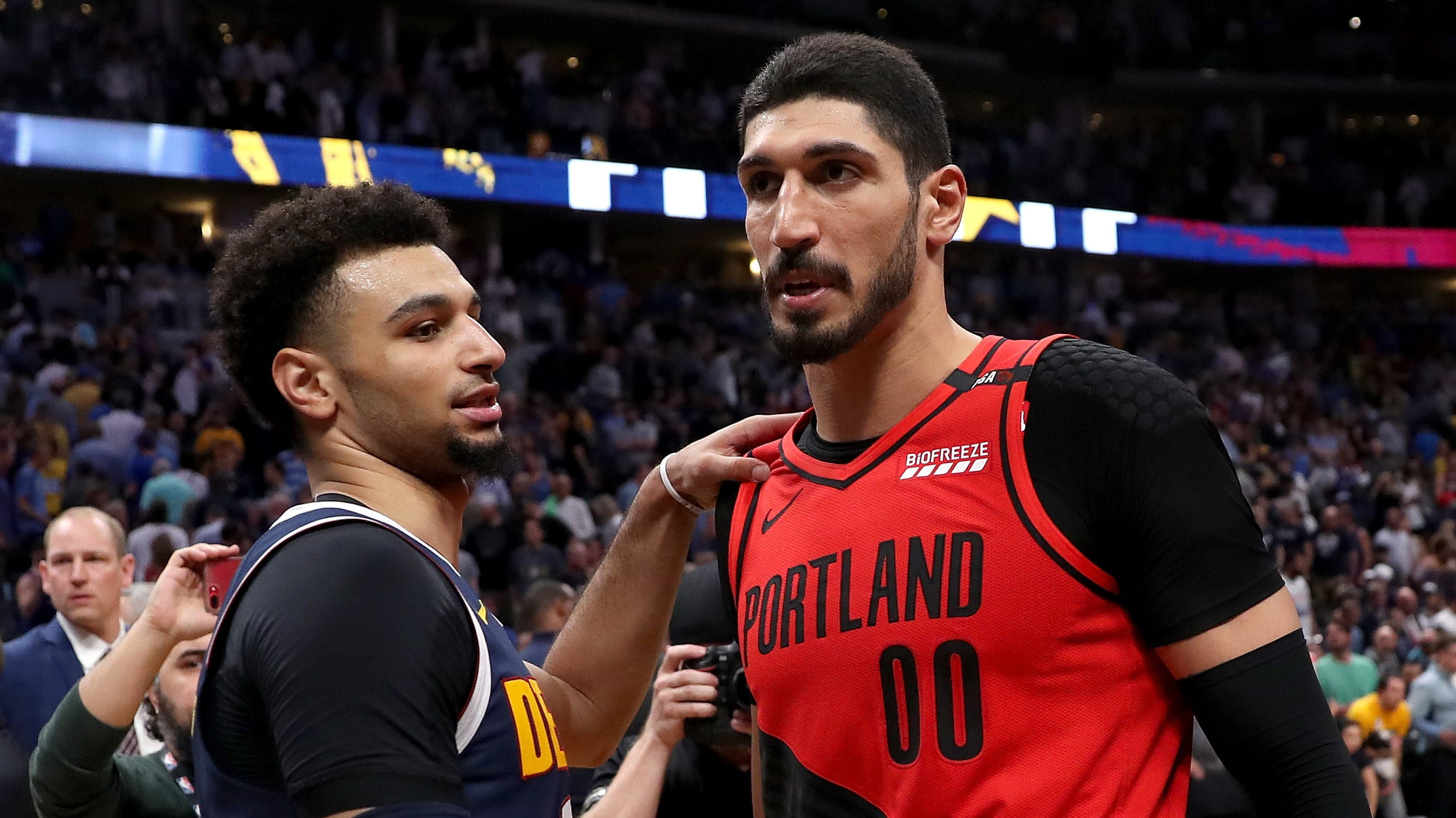 DENVER, COLORADO - MAY 12: Jamal Murray #27 of the Denver Nuggets congratulates Enes Kanter #00 the Portland Trail Blazers on their win during Game Seven of the Western Conference Semi-Finals of the 2019 NBA Playoffs at the Pepsi Center on May 12, 2019 in Denver, Colorado. NOTE TO USER: User expressly acknowledges and agrees that, by downloading and or using this photograph, User is consenting to the terms and conditions of the Getty Images License Agreement. (Photo by Matthew Stockman/Getty Images)