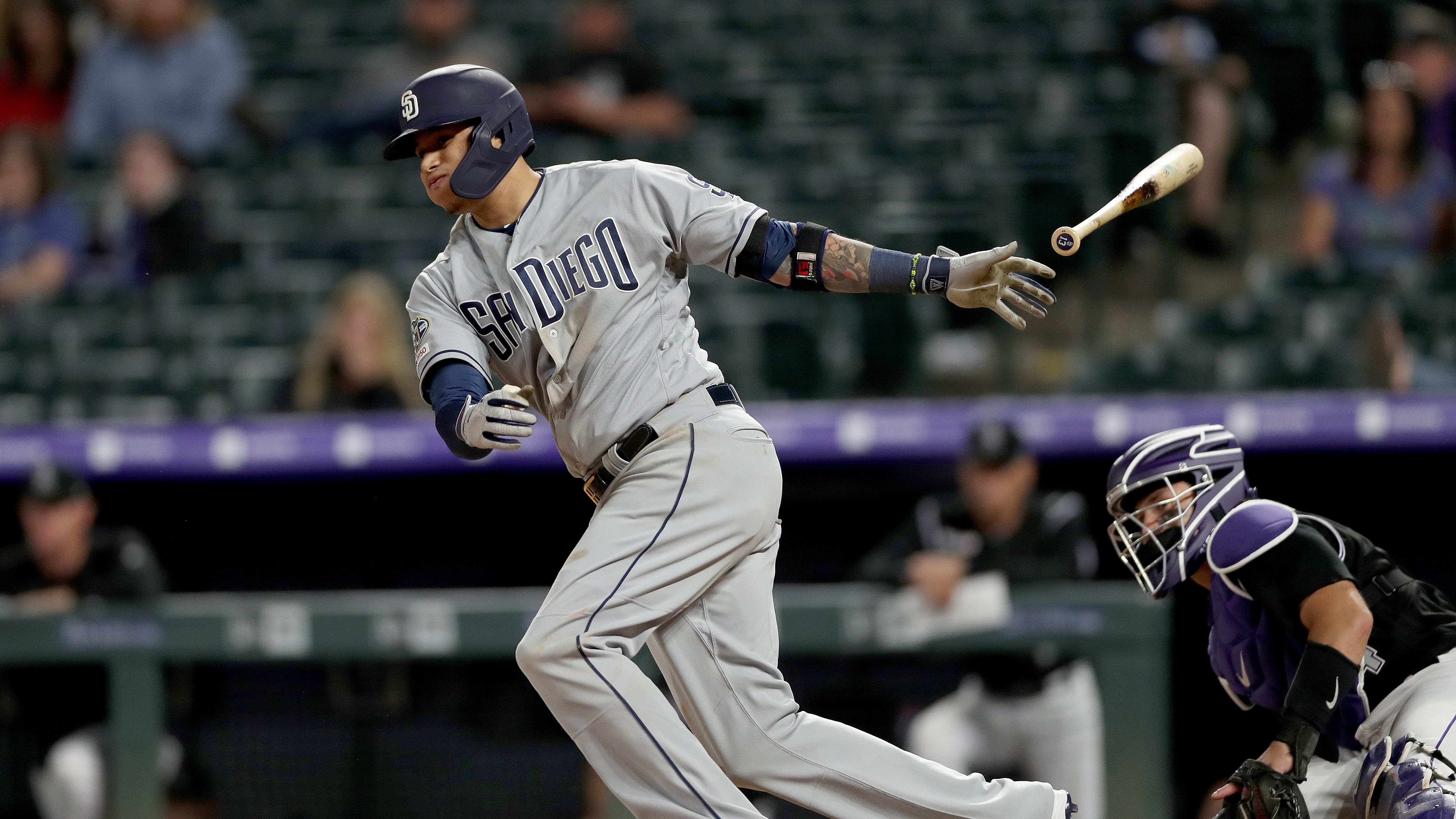 DENVER, COLORADO - JUNE 14: Manny Machado #13 of the San Diego Padres hits a RBI double in the 12th inning against the Colorado Rockies at Coors Field on June 14, 2019 in Denver, Colorado. (Photo by Matthew Stockman/Getty Images)