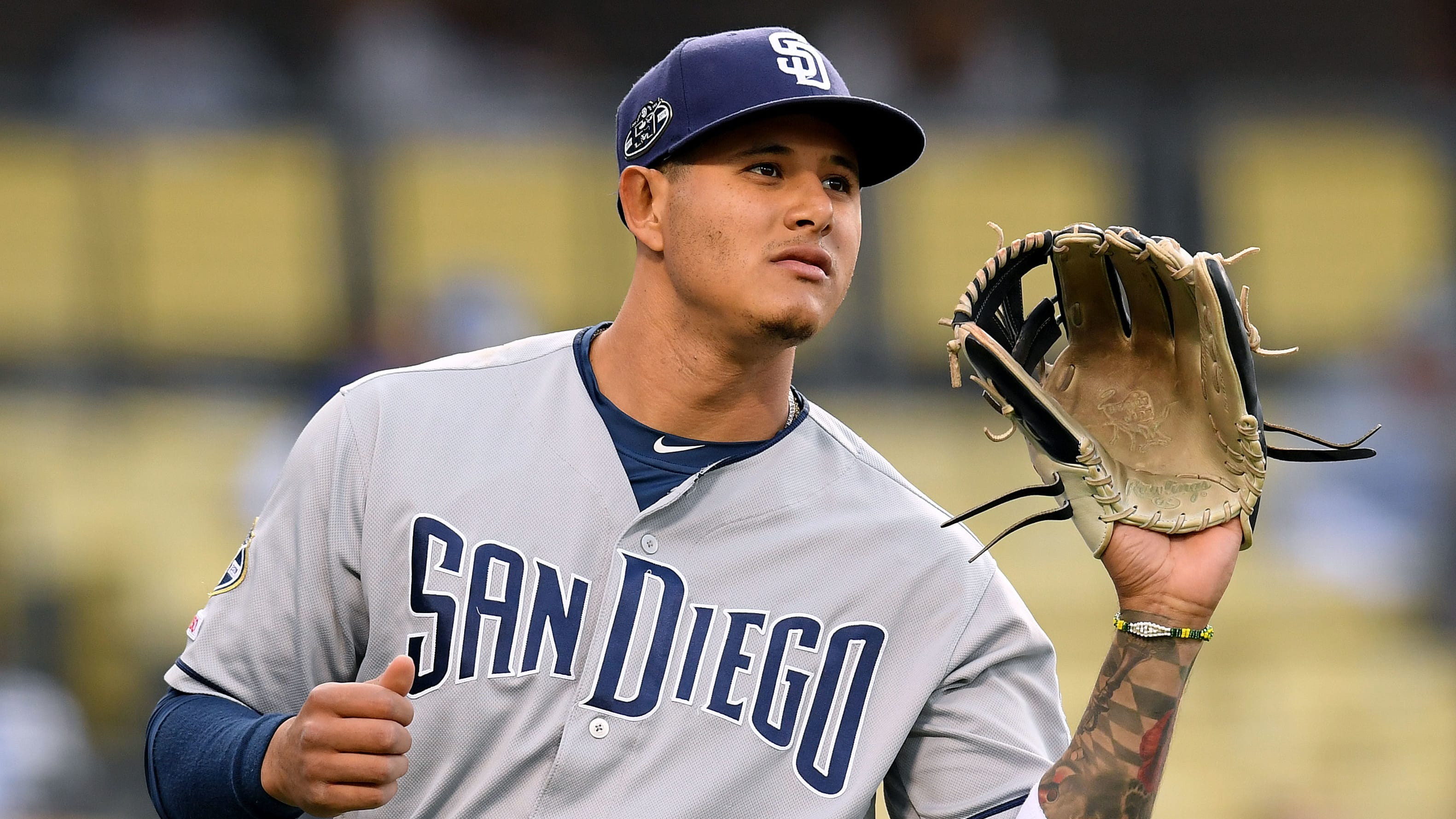 LOS ANGELES, CALIFORNIA - MAY 14:  Manny Machado #13 of the San Diego Padres warms up before the game against the Los Angeles Dodgers at Dodger Stadium on May 14, 2019 in Los Angeles, California. (Photo by Harry How/Getty Images)