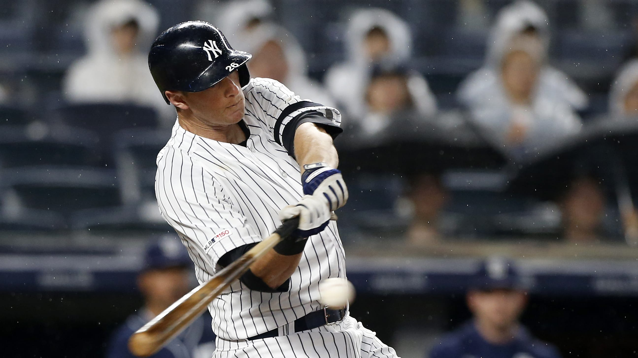 NEW YORK, NEW YORK - MAY 28:   DJ LeMahieu #26 of the New York Yankees hits a two-run single in the seventh inning against the San Diego Padres at Yankee Stadium on May 28, 2019 in New York City. (Photo by Jim McIsaac/Getty Images)