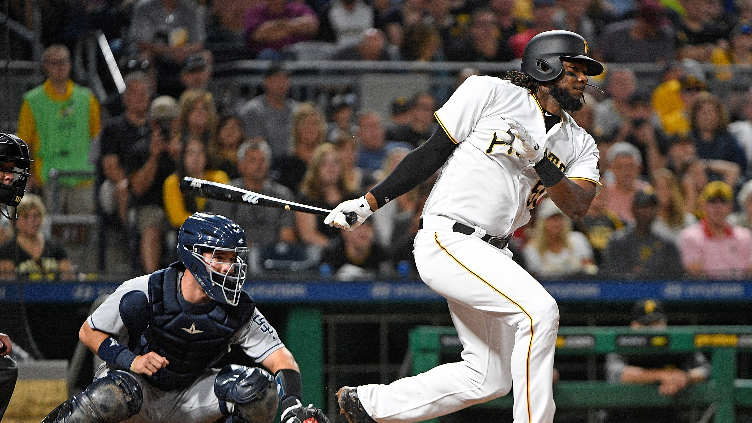 PITTSBURGH, PA - AUGUST 05:  Josh Bell #55 of the Pittsburgh Pirates singles to right field in the fourth inning during the game against the San Diego Padres at PNC Park on August 5, 2017 in Pittsburgh, Pennsylvania. (Photo by Justin Berl/Getty Images)