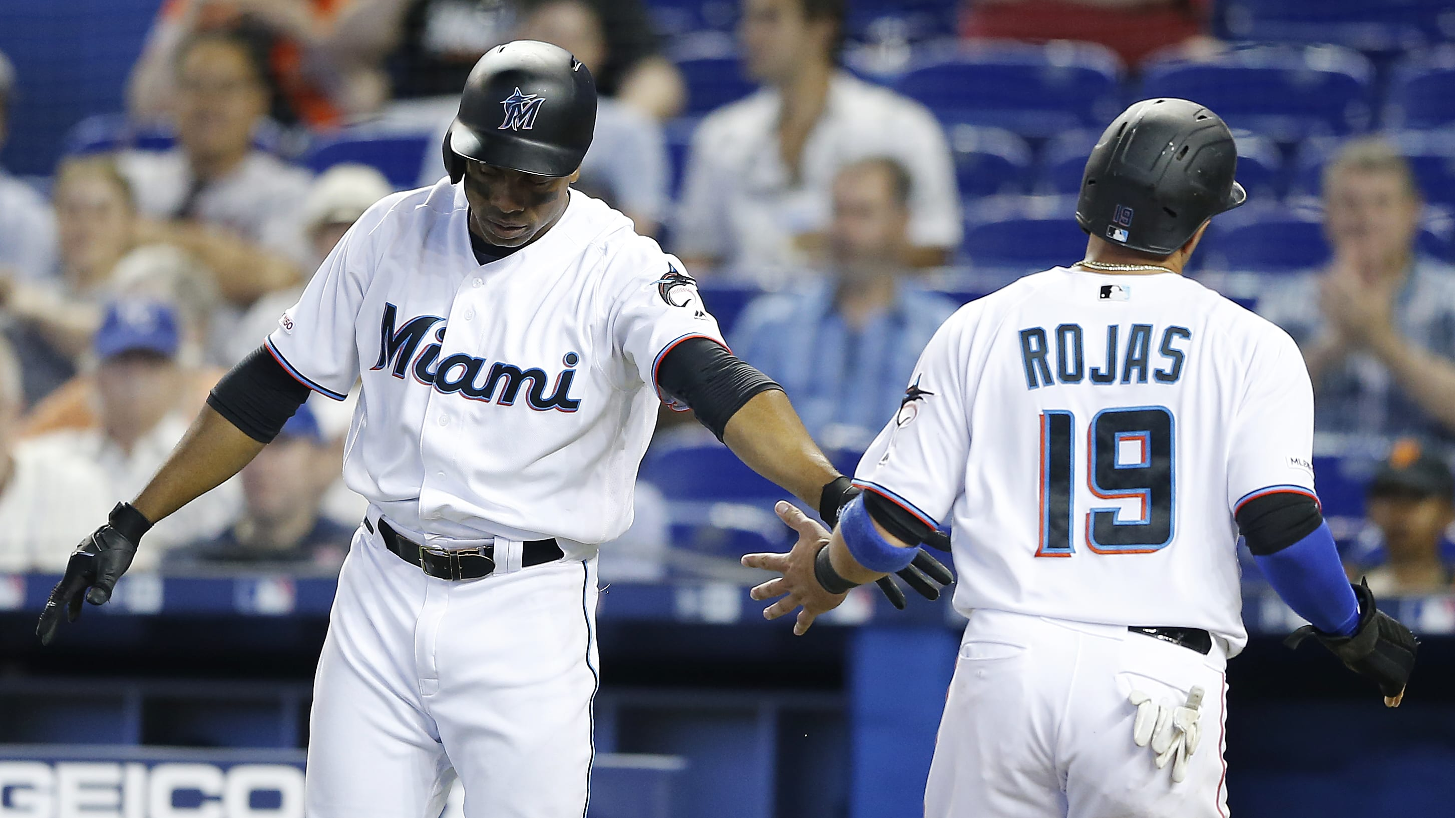 MIAMI, FLORIDA - MAY 30: Miguel Rojas #19 of the Miami Marlins celebrates with Curtis Granderson #21 after scoring a run in the second inning against the San Francisco Giants at Marlins Park on May 30, 2019 in Miami, Florida. (Photo by Michael Reaves/Getty Images)