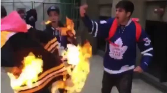 VIDEO: Maple Leafs' Fan Lights Bruins' Fan on Fire in Outrageous Staged Fight After Game 6 Win