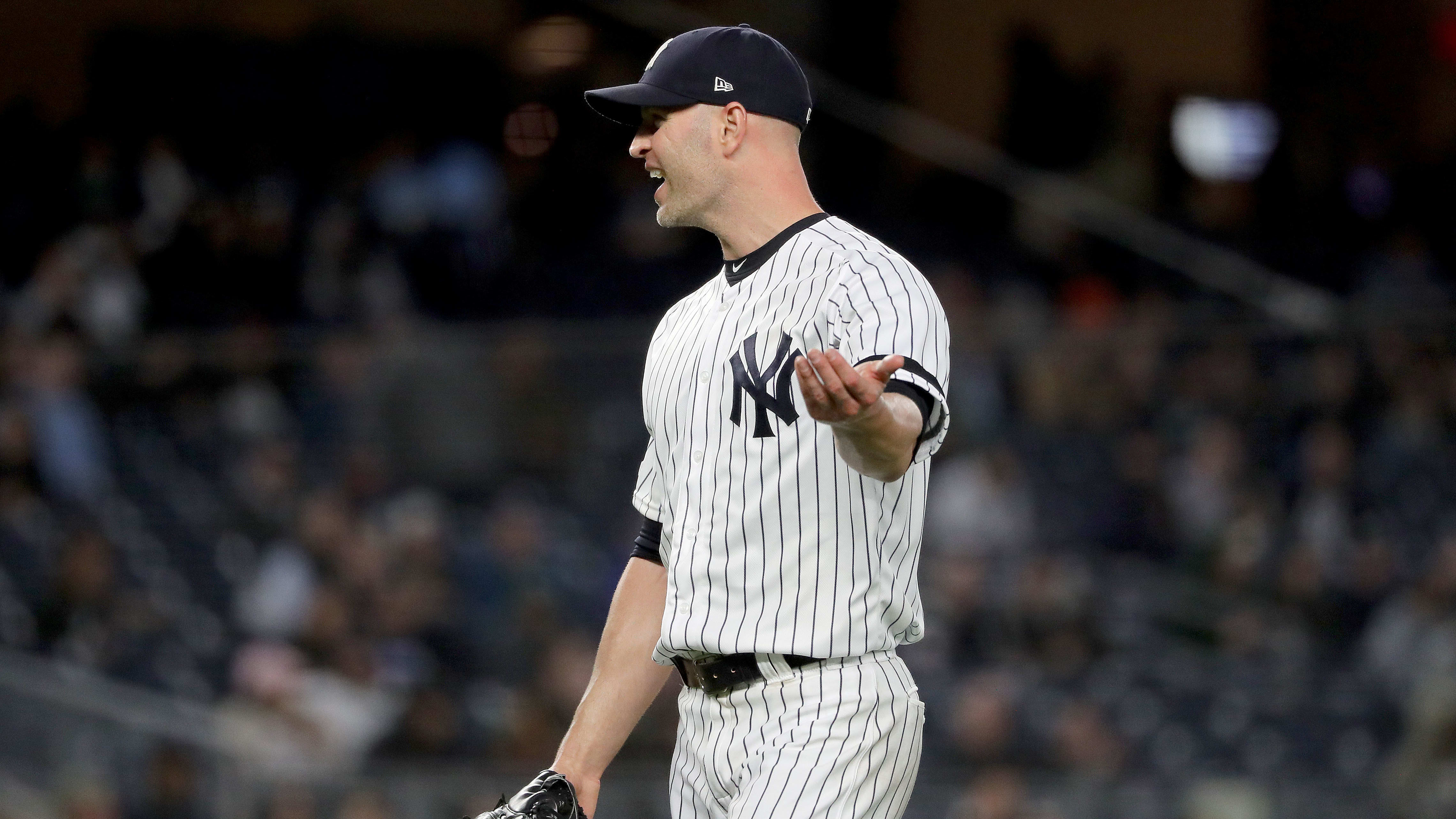 NEW YORK, NEW YORK - MAY 09:  J.A. Happ #34 of the New York Yankees reacts as he is pulled from the game in the sixth inning against the Seattle Mariners at Yankee Stadium on May 09, 2019 in the Bronx borough of New York City. (Photo by Elsa/Getty Images)
