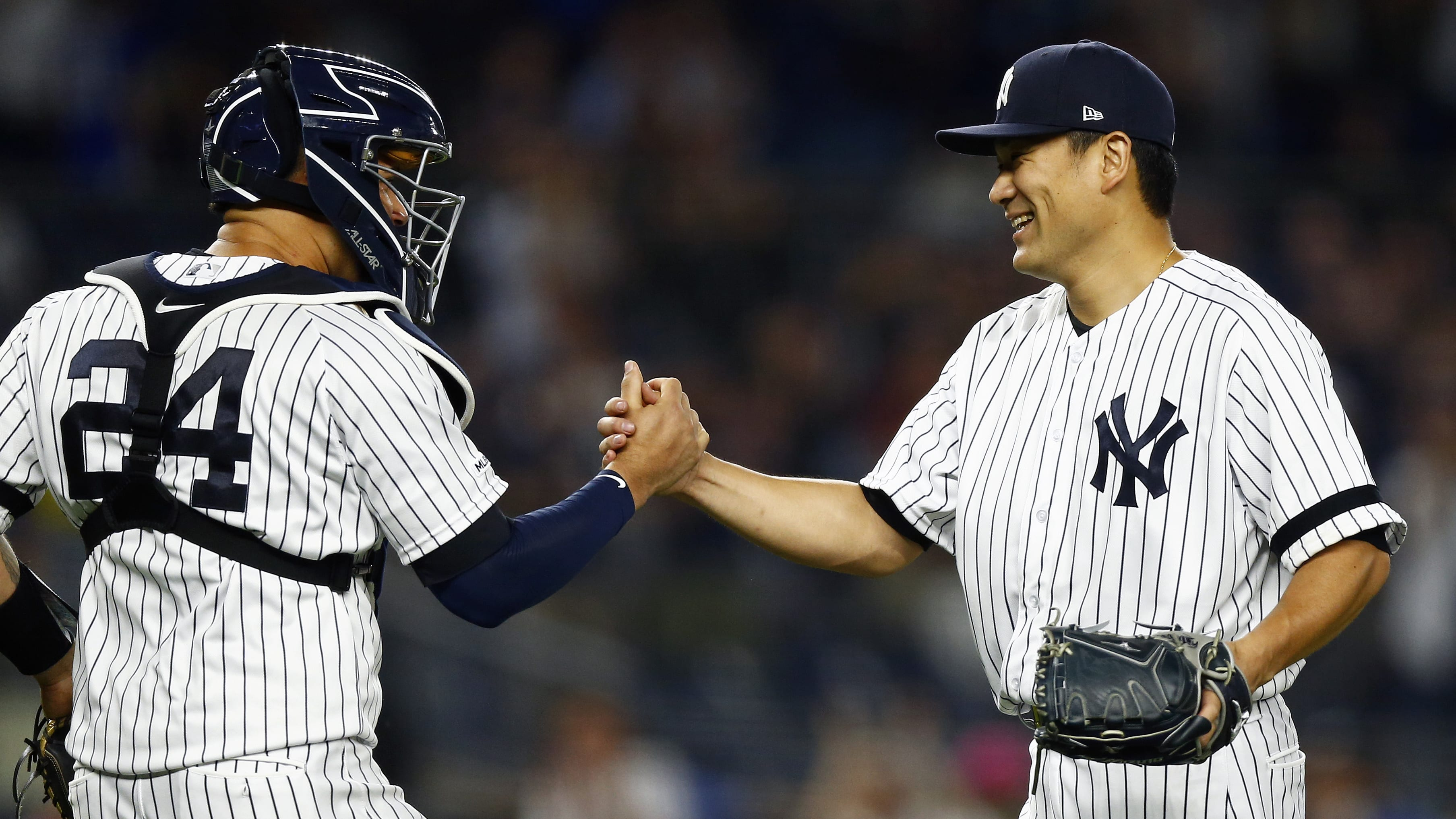 NEW YORK, NY - JUNE 17: Masahiro Tanaka #19 of the New York Yankees celebrates with Gary Sanchez #24 of the New York Yankees after defeating the Tampa Bay Rays at Yankee Stadium on June 17, 2019 in the Bronx borough of New York City. The Yankees won 3-0. (Photo by Adam Hunger/Getty Images)
