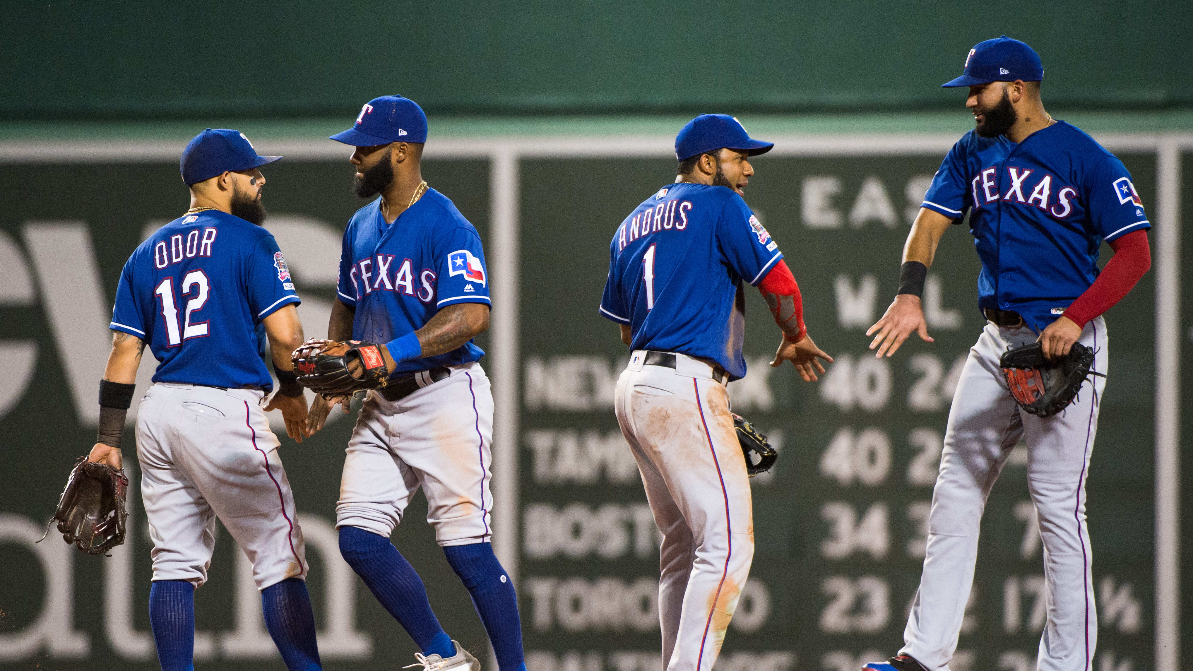 BOSTON, MA - JUNE 10: Elvis Andrus #1 and Rougned Odor #12 of the Texas Rangers celebrate with teammates after beating the Boston Red Sox at Fenway Park on June 10, 2019 in Boston, Massachusetts. (Photo by Kathryn Riley /Getty Images)