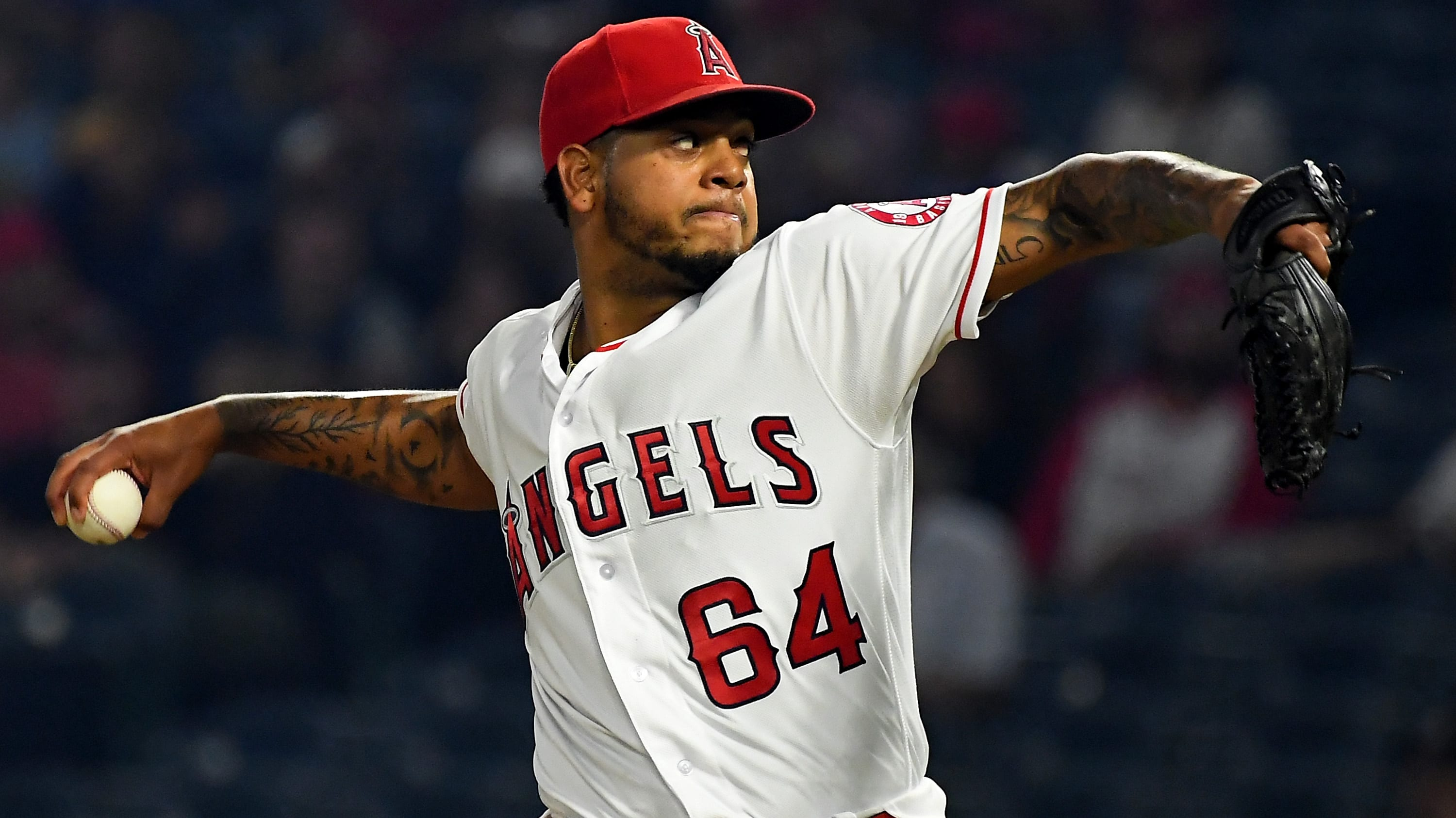 ANAHEIM, CA - SEPTEMBER 24:  Felix Pena #64 of the Los Angeles Angels of Anaheim pitches in the first inning of the game against the Texas Rangers at Angel Stadium on September 24, 2018 in Anaheim, California.  (Photo by Jayne Kamin-Oncea/Getty Images)