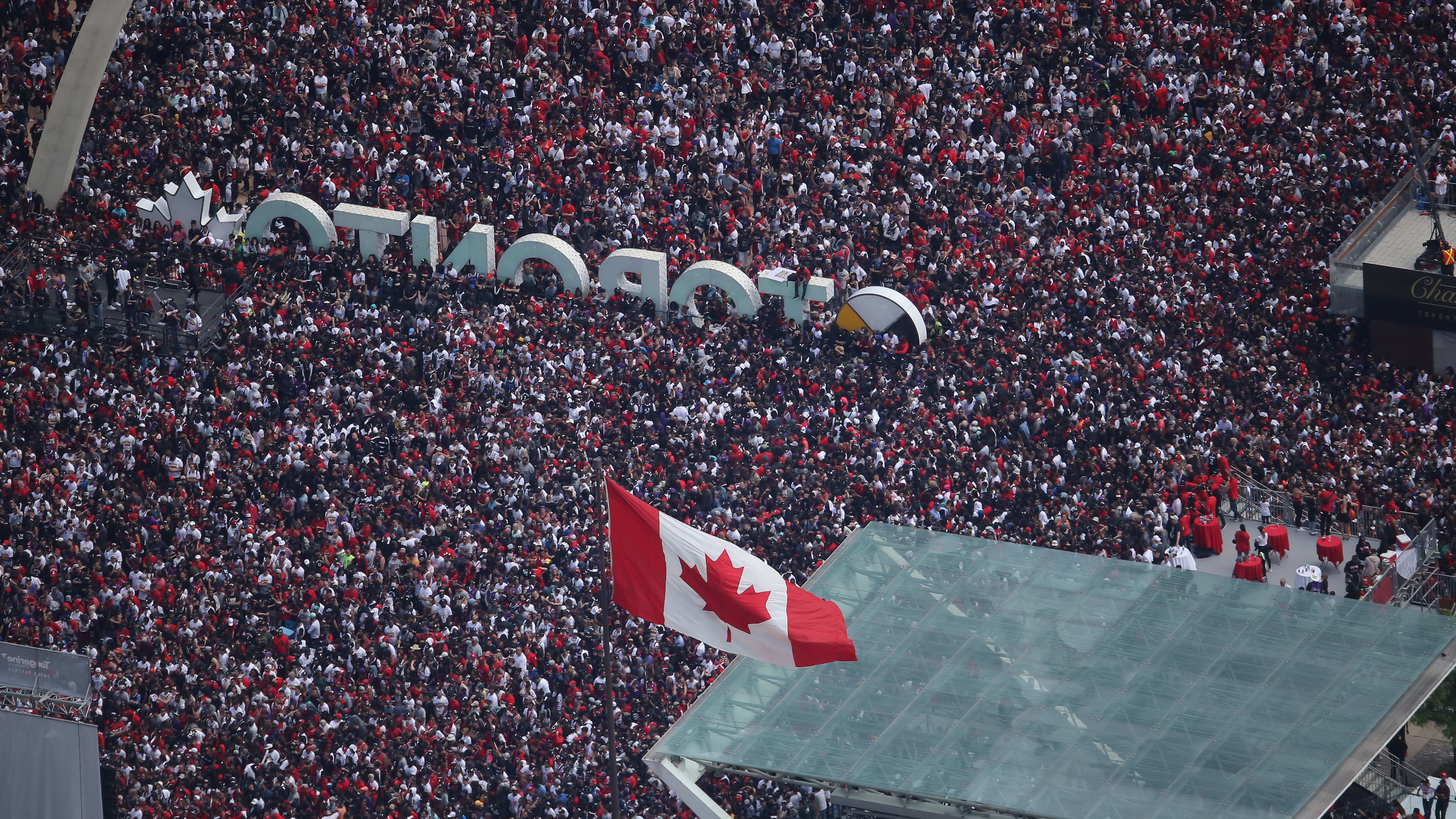 TORONTO, ON - JUNE 17: Fans gather at Nathan Phillips Square as they turn out for the Toronto Raptors NBA Championship Victory Parade after defeating the Golden State Warriors in the Finals on June 17, 2019 in Toronto, Canada. NOTE TO USER: User expressly acknowledges and agrees that, by downloading and or using this photograph, User is consenting to the terms and conditions of the Getty Images License Agreement. (Photo by Tom Szczerbowski/Getty Images)