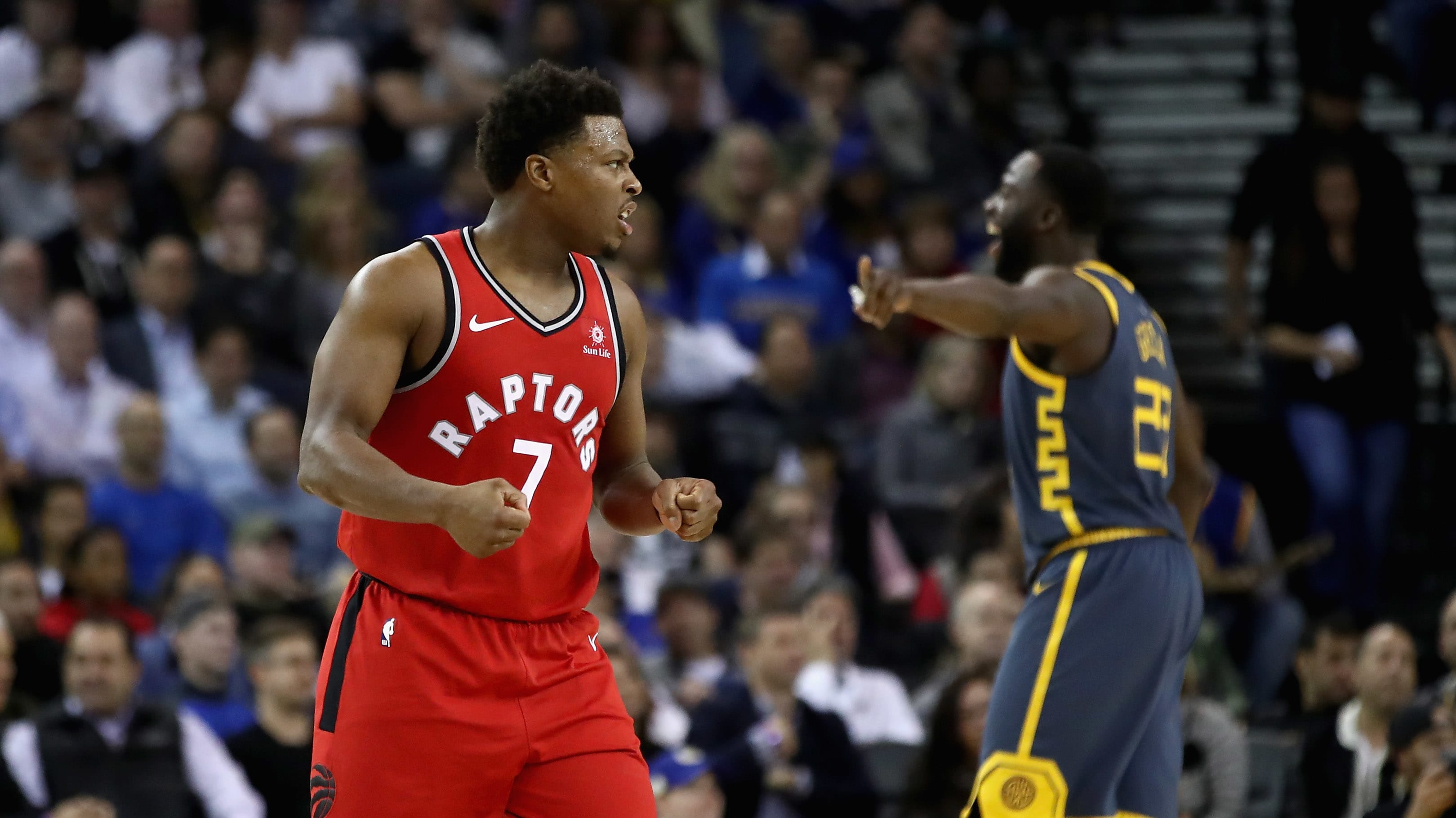 OAKLAND, CA - DECEMBER 12:  Kyle Lowry #7 of the Toronto Raptors reacts after Greg Monroe #15 made a basket against the Golden State Warriors at ORACLE Arena on December 12, 2018 in Oakland, California.  NOTE TO USER: User expressly acknowledges and agrees that, by downloading and or using this photograph, User is consenting to the terms and conditions of the Getty Images License Agreement.  (Photo by Ezra Shaw/Getty Images)