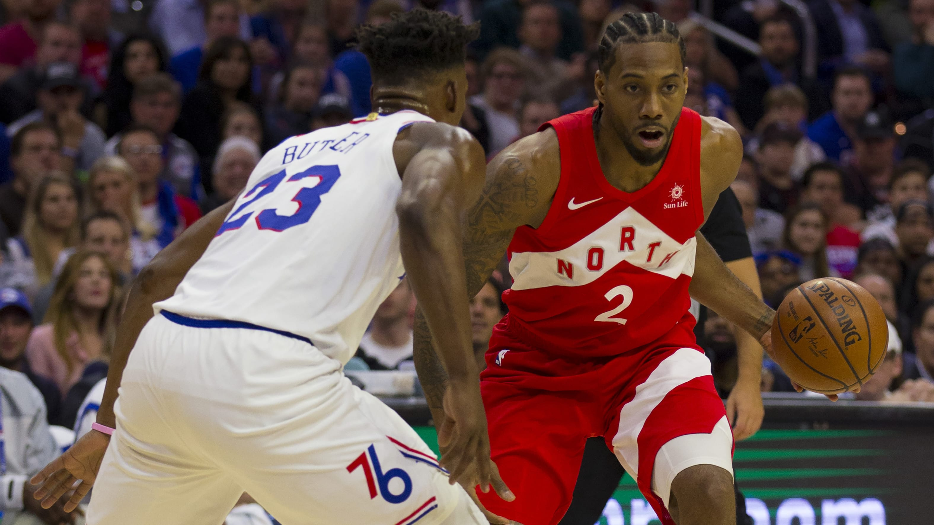 PHILADELPHIA, PA - MAY 09: Kawhi Leonard #2 of the Toronto Raptors dribbles the ball against Jimmy Butler #23 of the Philadelphia 76ers in Game Six of the Eastern Conference Semifinals at the Wells Fargo Center on May 9, 2019 in Philadelphia, Pennsylvania. The 76ers defeated the Raptors 112-101. NOTE TO USER: User expressly acknowledges and agrees that, by downloading and or using this photograph, User is consenting to the terms and conditions of the Getty Images License Agreement. (Photo by Mitchell Leff/Getty Images)