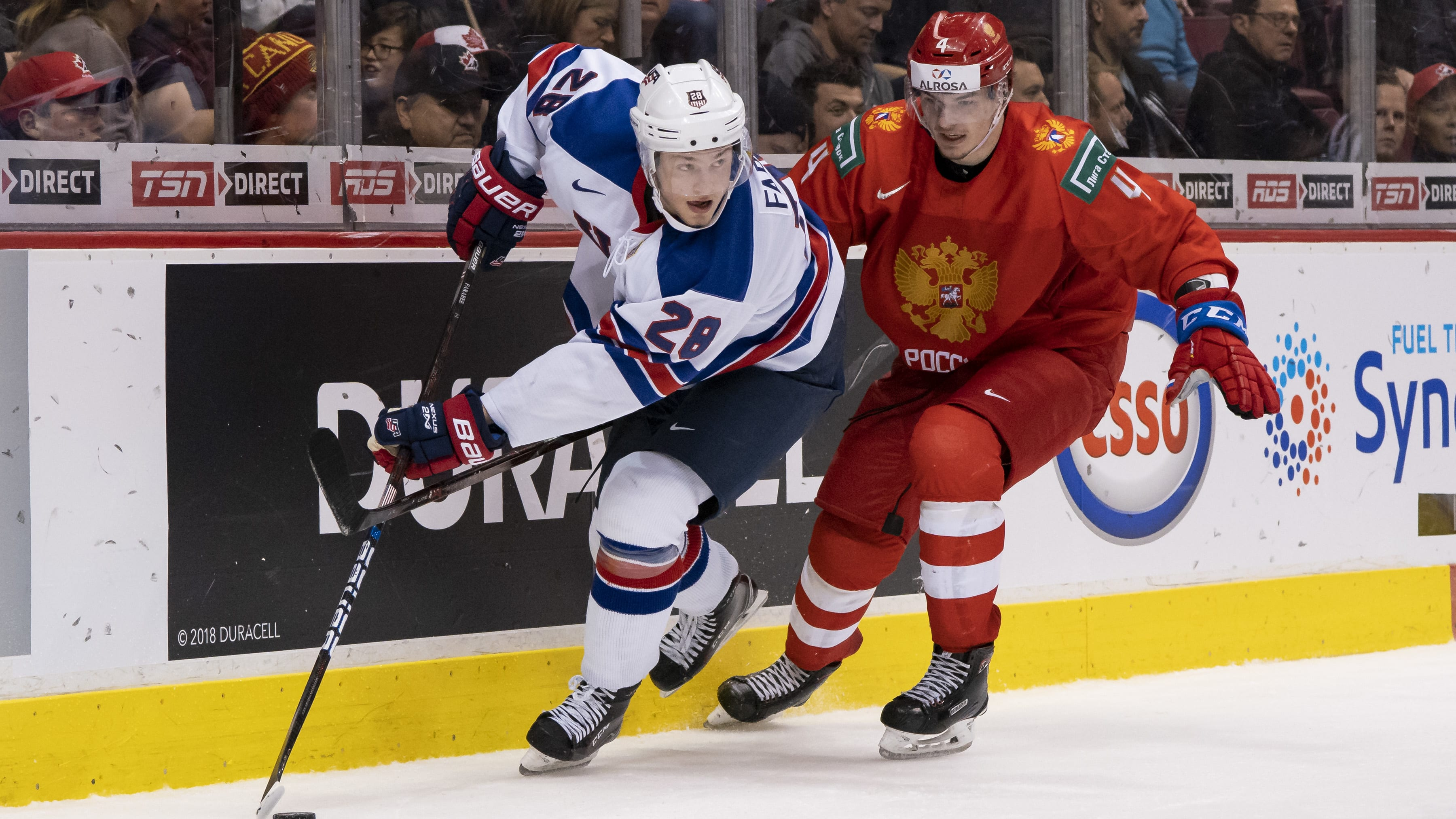 VANCOUVER, BC - JANUARY 4: Alexander Alexeyev #4 of Russia tries to check Joel Farabee #28 of the United States in Semifinals hockey action of the 2019 IIHF World Junior Championship on January, 4, 2019 at Rogers Arena in Vancouver, British Columbia, Canada.  (Photo by Rich Lam/Getty Images)