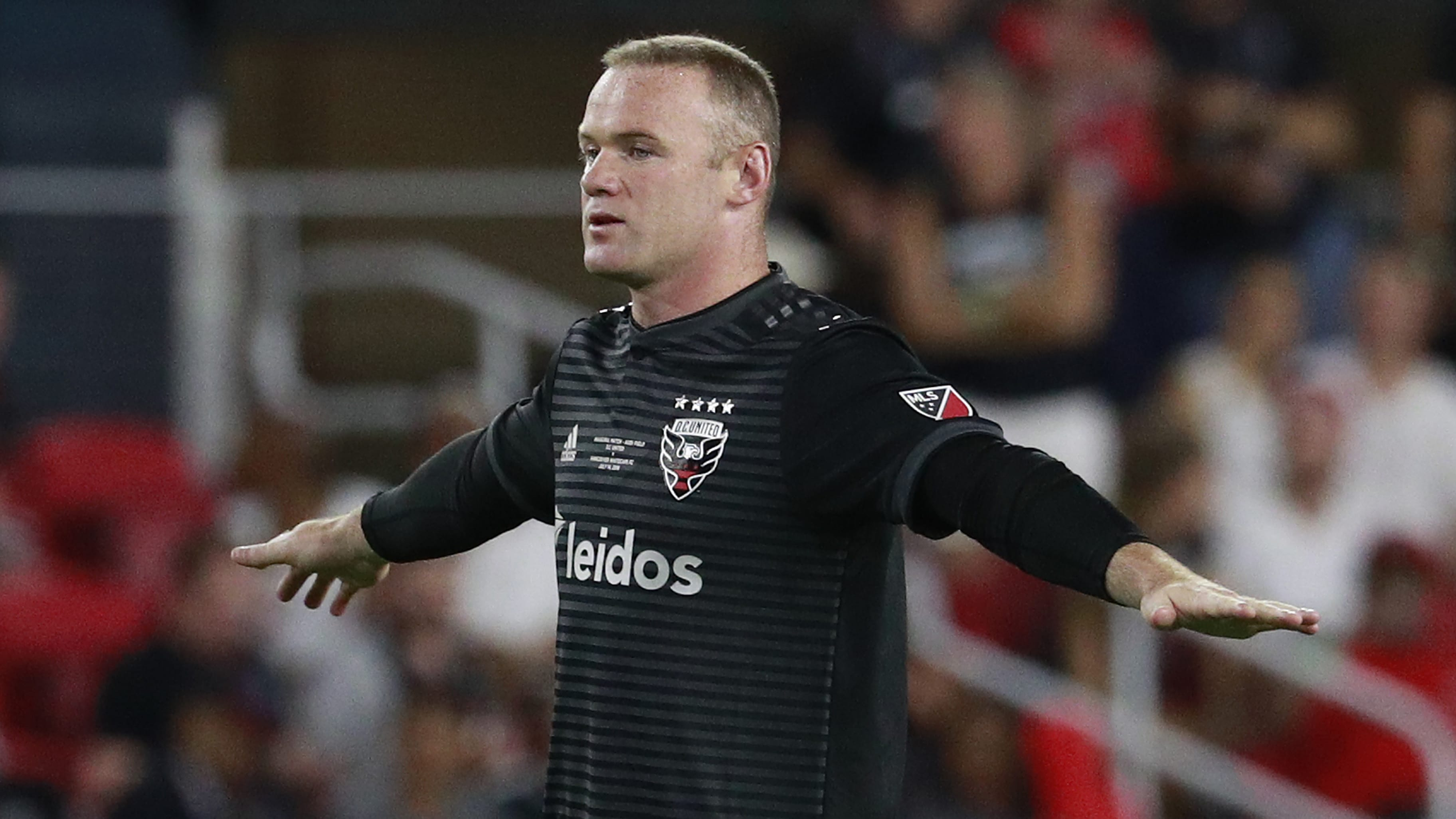 WASHINGTON, DC - JULY 14: Wayne Rooney #9 of D.C. United in action second half against the Vancouver Whitecaps during his MLS debut at Audi Field on July 14, 2018 in Washington, DC. (Photo by Patrick McDermott/Getty Images)
