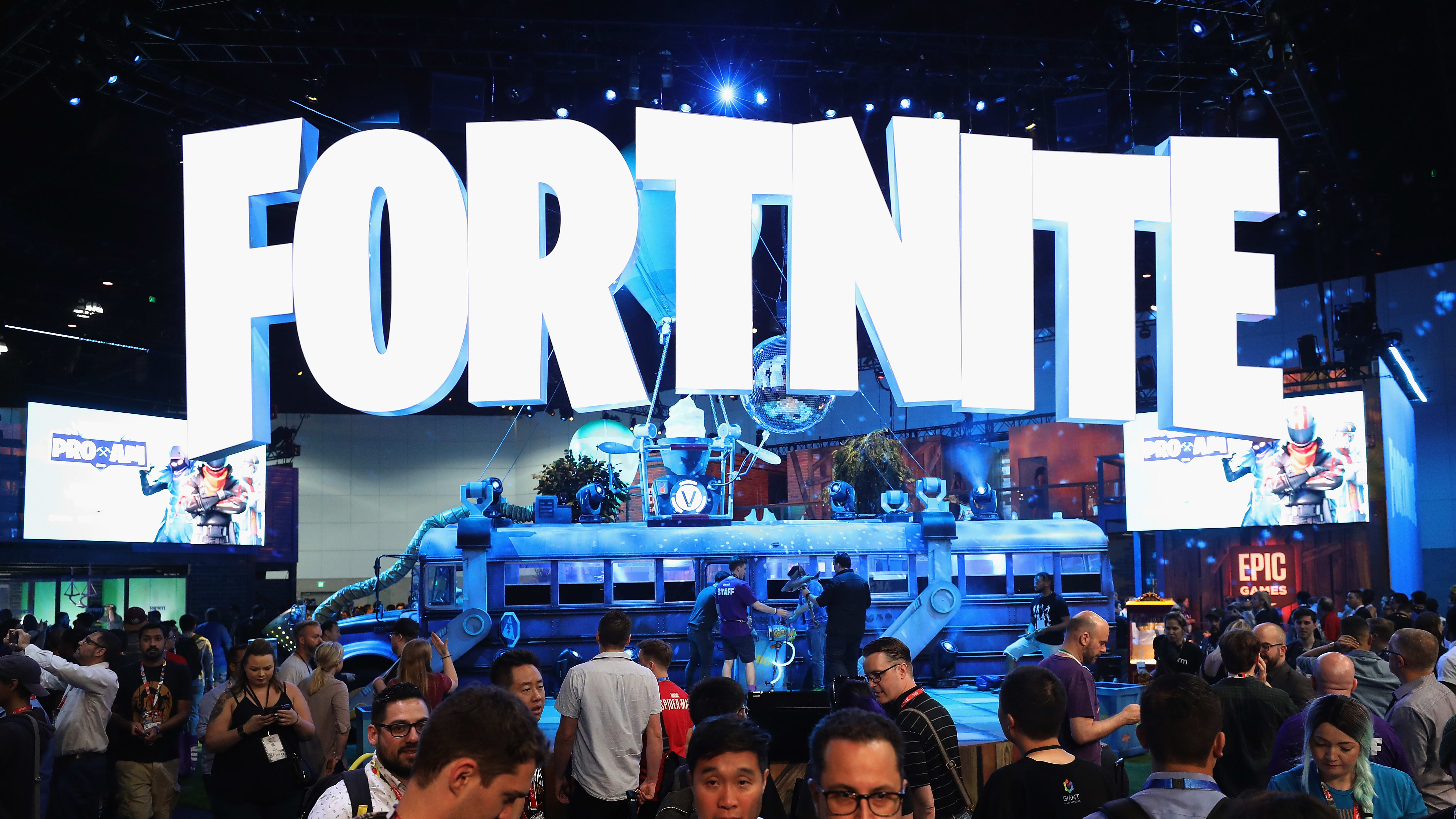 LOS ANGELES, CA - JUNE 12:  Game enthusiasts and industry personnel visit the 'Fortnite' exhibit during the Electronic Entertainment Expo E3 at the Los Angeles Convention Center on June 12, 2018 in Los Angeles, California.  (Photo by Christian Petersen/Getty Images)