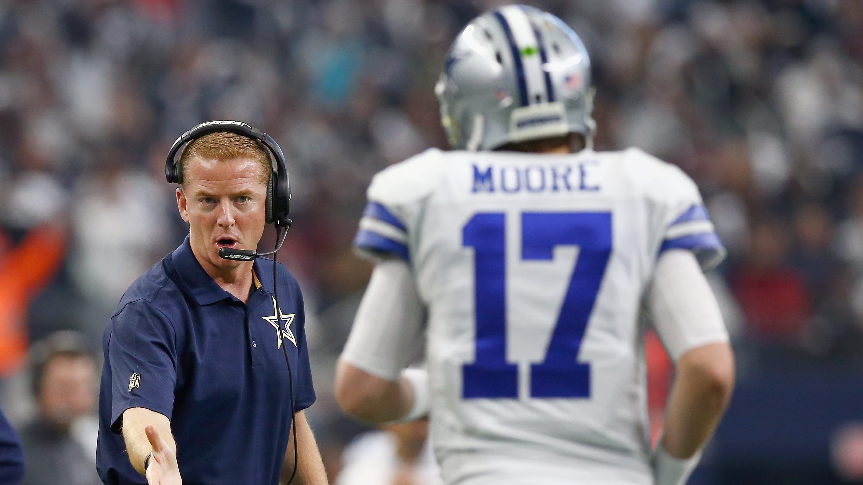 ARLINGTON, TX - JANUARY 03:  Head coach Jason Garrett of the Dallas Cowboys celebrates with Kellen Moore #17 of the Dallas Cowboys after the Cowboys scored against the Washington Redskins in the second quarter at AT&T Stadium on January 3, 2016 in Arlington, Texas.  (Photo by Tom Pennington/Getty Images)