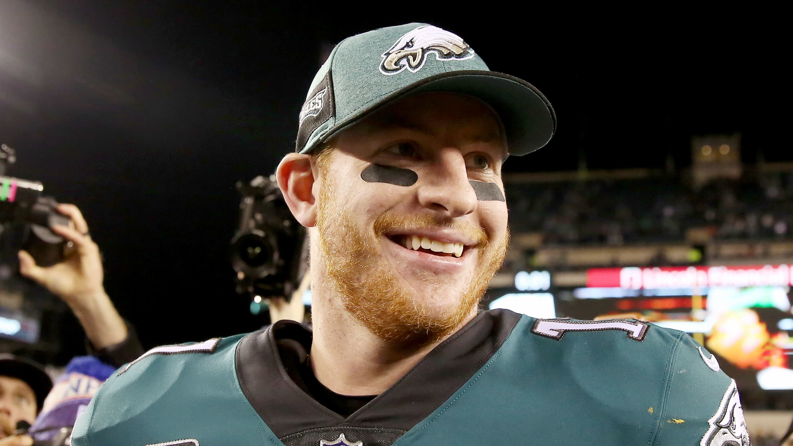 PHILADELPHIA, PENNSYLVANIA - DECEMBER 03:  Carson Wentz #11 of the Philadelphia Eagles smiles as he walks off the field after the game at Lincoln Financial Field on December 03, 2018 in Philadelphia, Pennsylvania. The Philadelphia Eagles defeated the Washington Redskins 28-13.(Photo by Elsa/Getty Images)